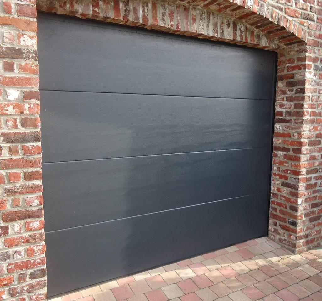 Porte de garage sectionnelle finition woodgrain for Porte de garage fame avis